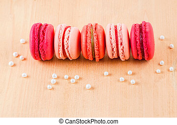 strawberry, raspberry and rhubarb macarons on wooden table