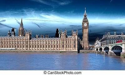 London, the UK Red bus in motion and Big Ben, the Palace of...