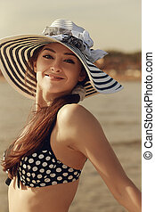 Happy bikini woman in hat on beach background. Vintage...