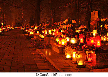 cementary by night- candles on the graves