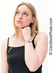 thinking woman looking at her watch