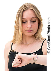 woman looking at her watch