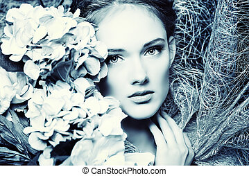 inflorescence - Portrait of a beautiful girl with flowers...