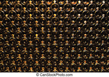 Wine bottles - Large stack of wine bottle bottoms in winery