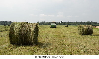 tractor gather hay bale - Straw bales and agricultural...