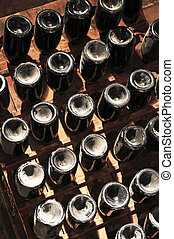 Wine bottles - Upside down wine bottles maturing in wooden...