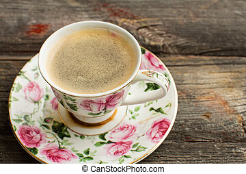 Cup of freshly brewed Turkish coffee in a pretty floral...
