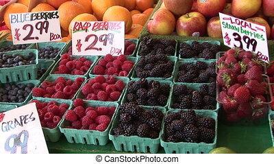 Fresh Berries in a Marketplace - Blueberries, raspberries,...