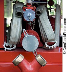 Firehose and valveson a firetruck in Worwich, Ontario,...