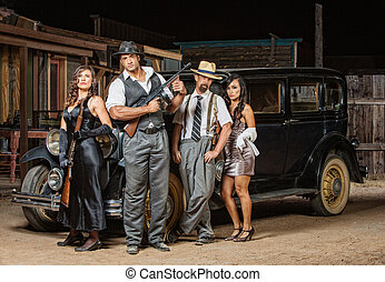 Four Gangsters Posing - Group of male and female gangsters...