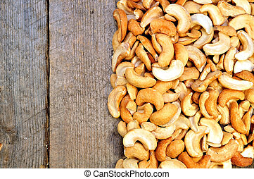 cashew nuts on a wooden table