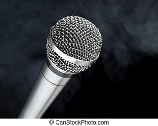 Microphone on stage - A dynamic microphone over a black and...