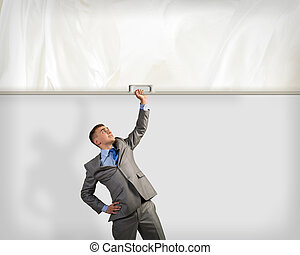 businessman holding a banner with one hand