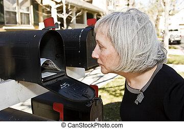 Mature Woman at Mailbox