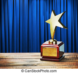Star award wooden table and on the background of blue...