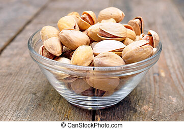 pistachios into a bowl on the table