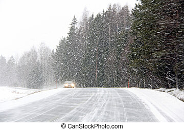 Car in Blizzard - Car driving on a rural road in a snowstorm...