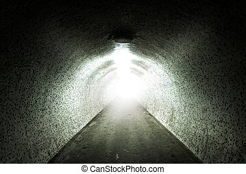 Light at the end of a tunnel with tiled wall