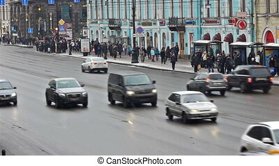 Day car traffic and crowdy pavement of Nevsky prospect