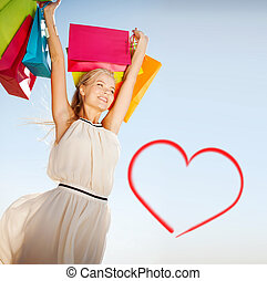 woman with shopping bags - shopping and tourism concept -...