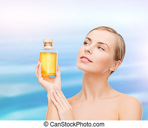 lovely woman with oil bottle - health, spa and beauty...