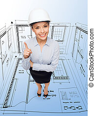 businesswoman in white helmet with finger up - building,...