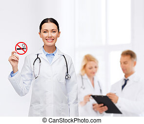 smiling female doctor with stethoscope - healthcare and...