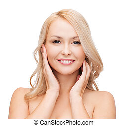 woman touching her face skin - heath and beauty concept -...