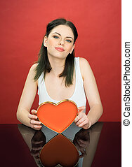 Beautiful young woman with a Valentines heart