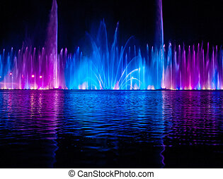 Musical fountain with colorful illuminations at night....