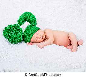 Newborn baby boy - sweet newborn baby boy sleep in a green...