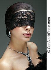 portrait elegant sexual brunette woman is in a black lace...
