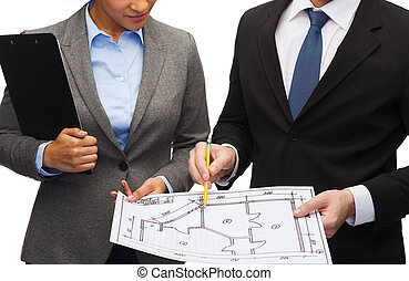 businesspeople with clipboard and blueprint