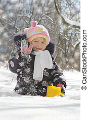 Girl having fun in snowy park