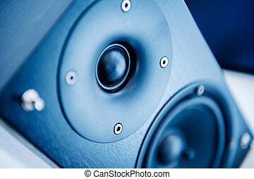 Speaker on in blue technological background