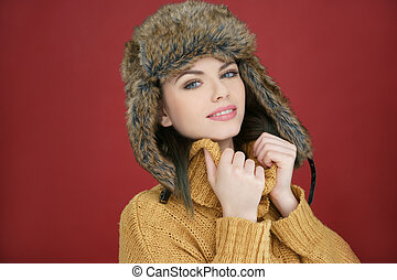 Beautiful happy young woman in winter fashion wearing a cute...