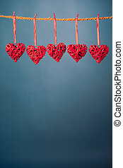 decorative valentine hearts on blue background