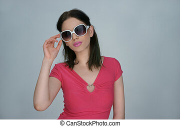 Woman in summer fashion with trendy sunglasses
