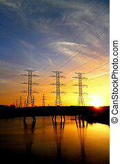 Power Line - High voltage power line towers on a field with...