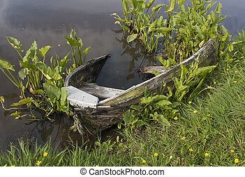 Wrecked row boat - An old abandoned row boat half submerged...
