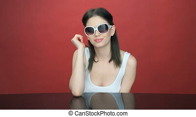 Beautiful young woman in trendy sunglasses