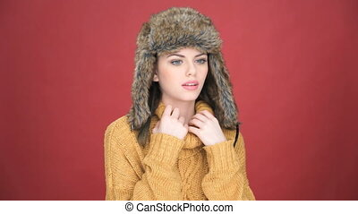 Beautiful young woman suffering from the cold