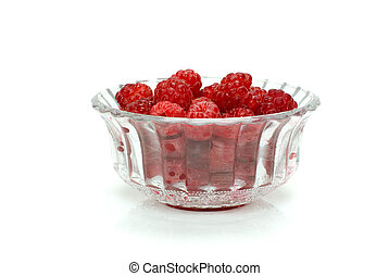 Raspberries in a crystal bowl isolated on the white...