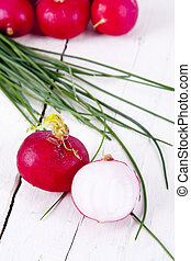 Fresh red radishes on white background
