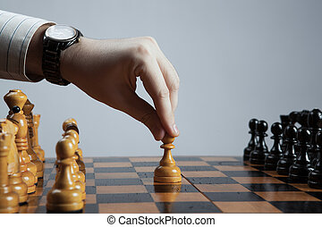 man makes a move chess pawn - hand of man making a move...