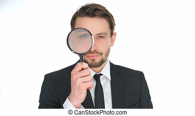 Businessman looking through a magnifying glass enlarging one...