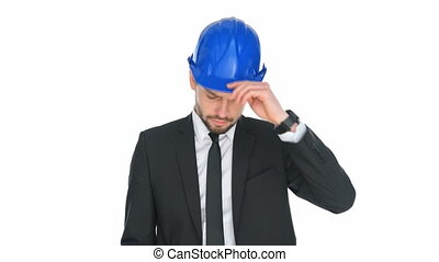 Engineer in a hardhat giving a public speech or issuing...