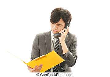 Depressed Asian businessman. - Tired and stressed Asian...