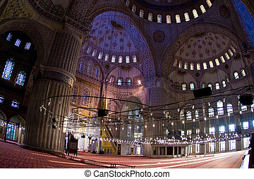 the Blue Mosque in Istanbul, Turkey. - A stock photograph of...