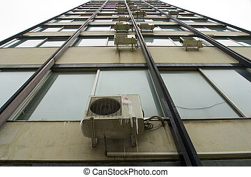 an air conditioner with icicles forming over it suggesting...